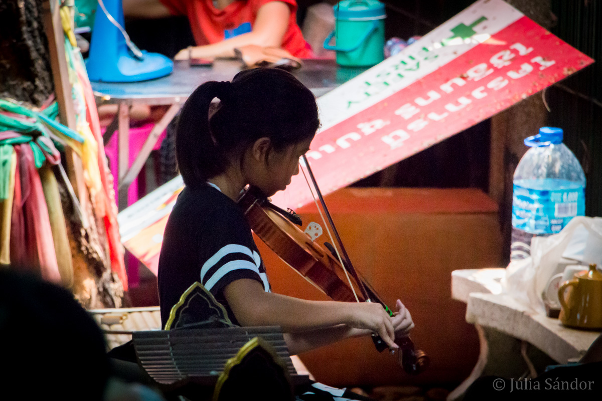 Faces of Asia: Violin playing girl in Bangkok