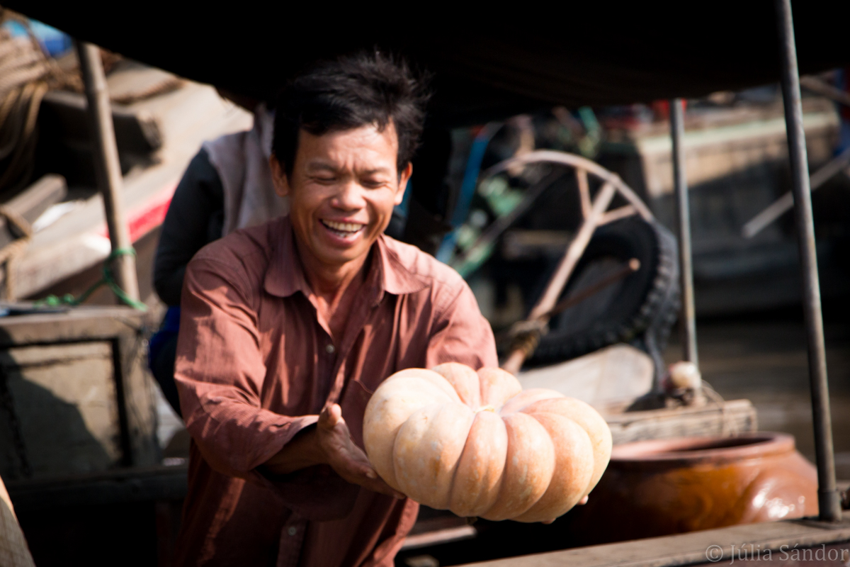 Faces of Asia: Pumpkin vendor in the floating market