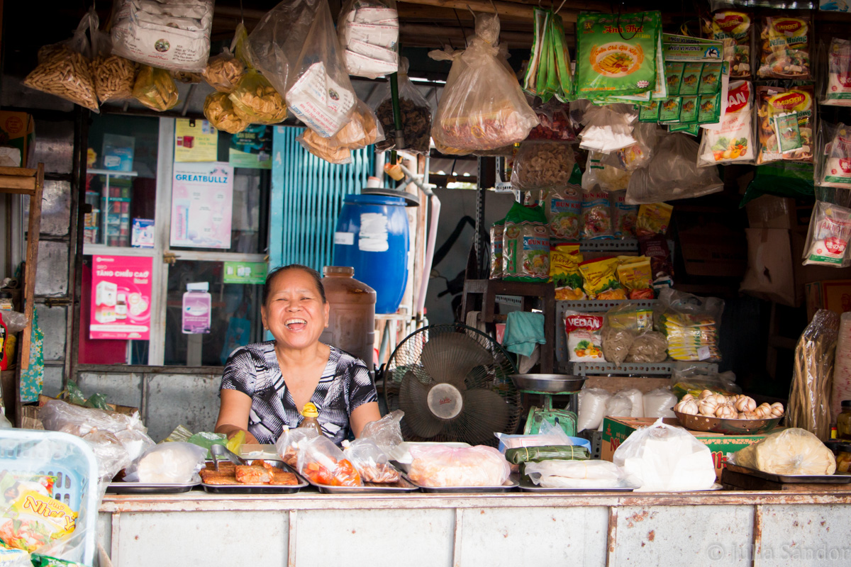 Faces of Asia: Laughing vendor at the market in Vietnam