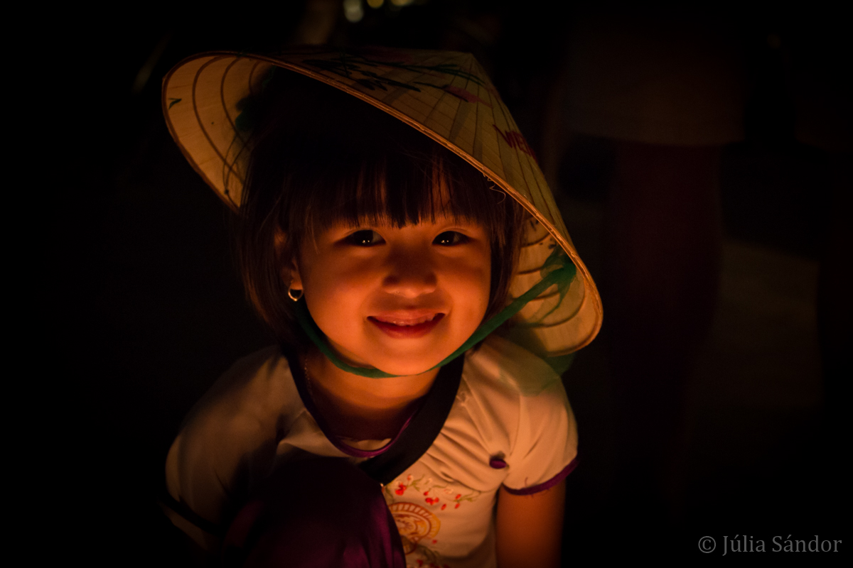 Faces of Asia: Vietnamese girl in the light of candles