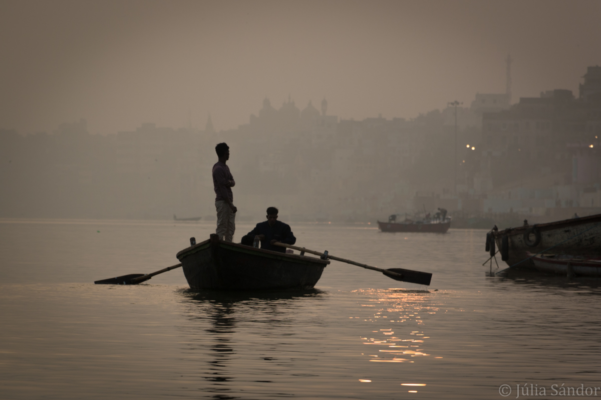 Boat on the foggy Ganges River
